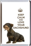 A fridge magnet with a picture of a Wire Haired Dachshund Dog with the wording KEEP CALM AND LOVE YOUR DACHSHUND.